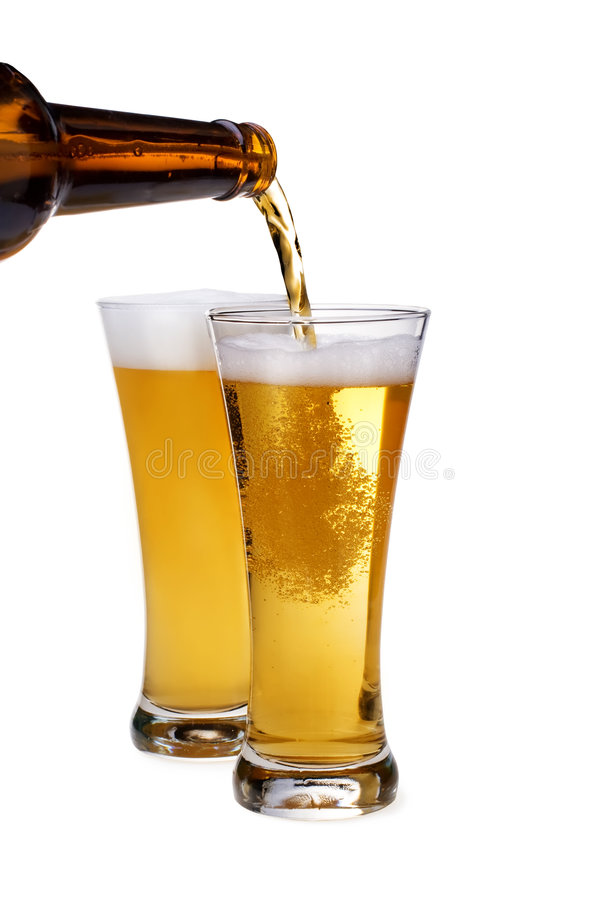 的啤酒玻璃倾吐 免版税图库摄影