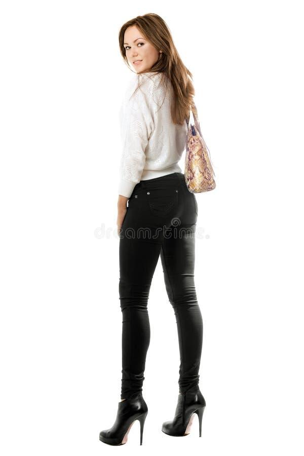 黑紧的牛仔裤的微笑的女孩 库存照片