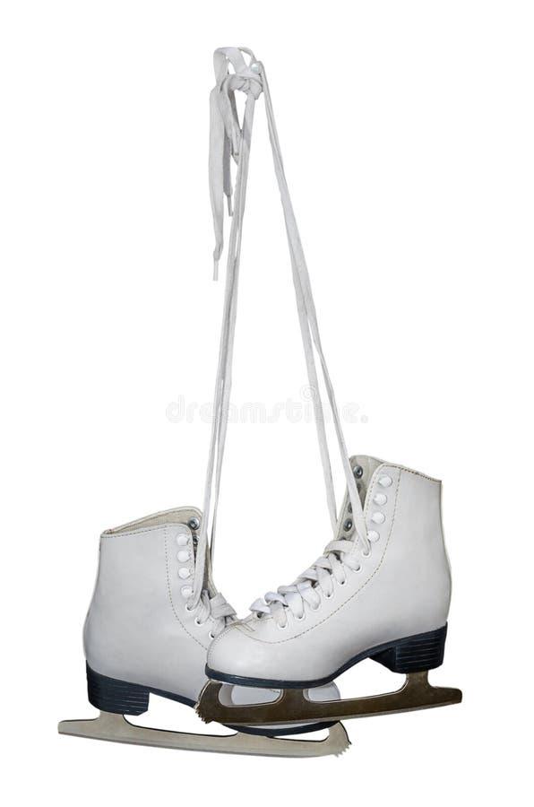 的花样滑冰老白色冰鞋与 选择的道路 背景查出的白色 库存图片