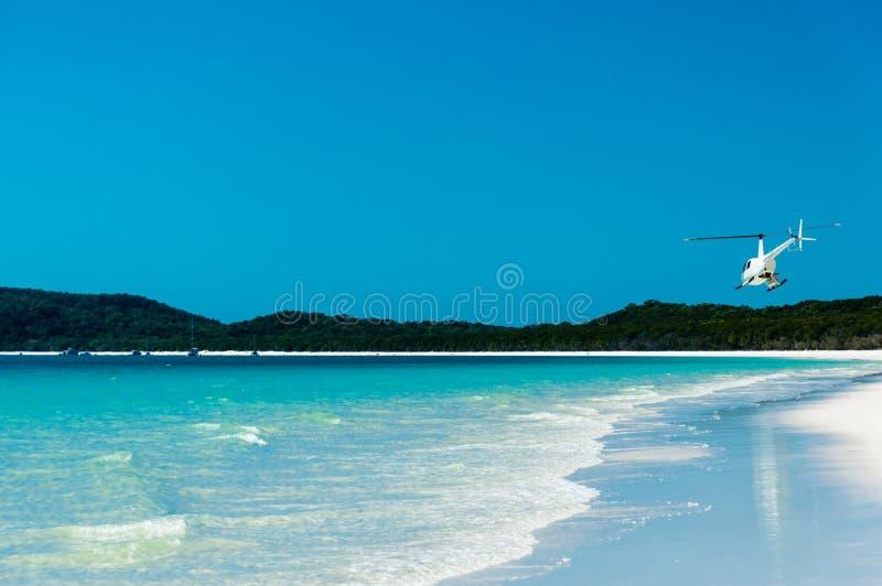 离去的直升机, Whitehaven海滩我 库存照片
