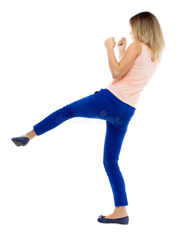 皮包骨头的挥动他的胳膊和腿的妇女滑稽的战斗 库存照片