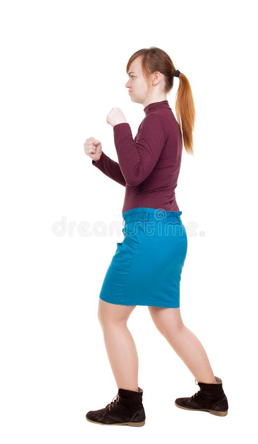 皮包骨头的挥动他的胳膊和腿的妇女滑稽的战斗 免版税库存图片
