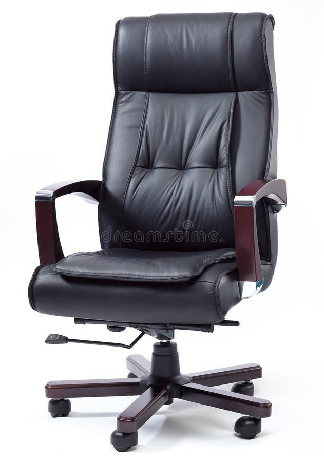 黑皮革上司椅子 免版税库存照片