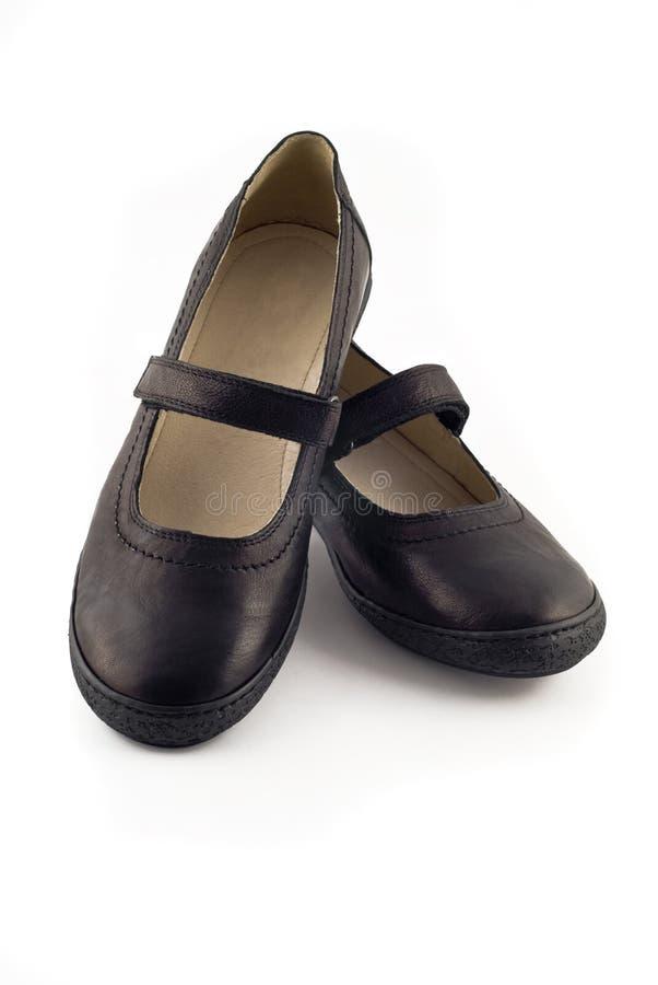 皮革现代在s穿上鞋子白人妇女 免版税库存图片