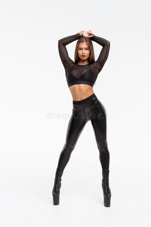 皮革裤子和脚跟的色情妇女 图库摄影