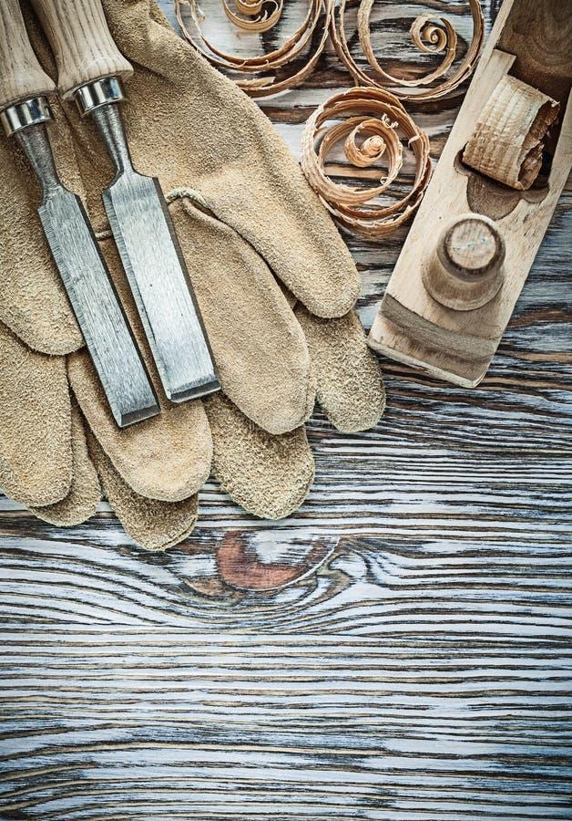 皮革防护手套混在一起锤子计划ch的凿子整平机 免版税库存照片