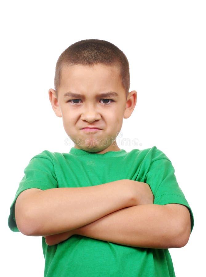 皱眉头恼怒的孩子 免版税库存照片