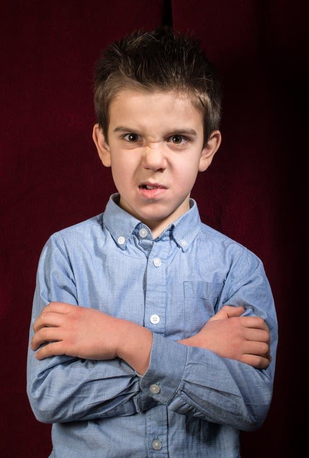 皱眉的男孩 免版税图库摄影