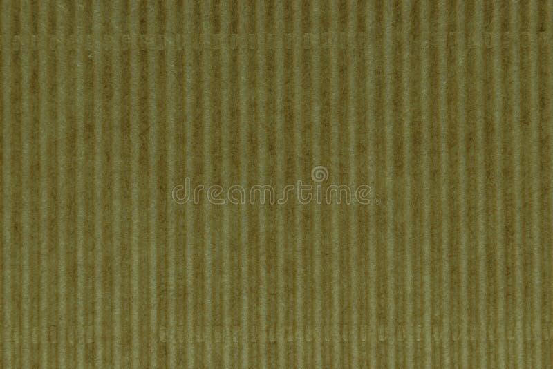 皱纸板背景表面的黄色样式 免版税库存照片