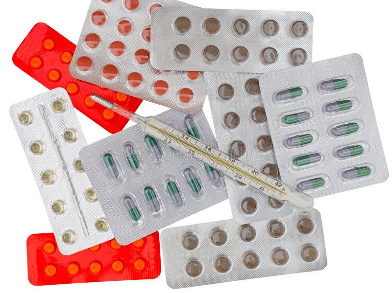 盒药片和termometer 库存图片