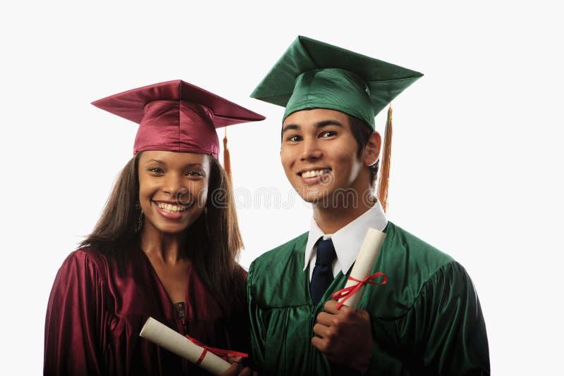 盖帽夫妇褂子多种族 免版税图库摄影