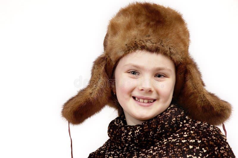 盖帽女孩纵向冬天 免版税图库摄影