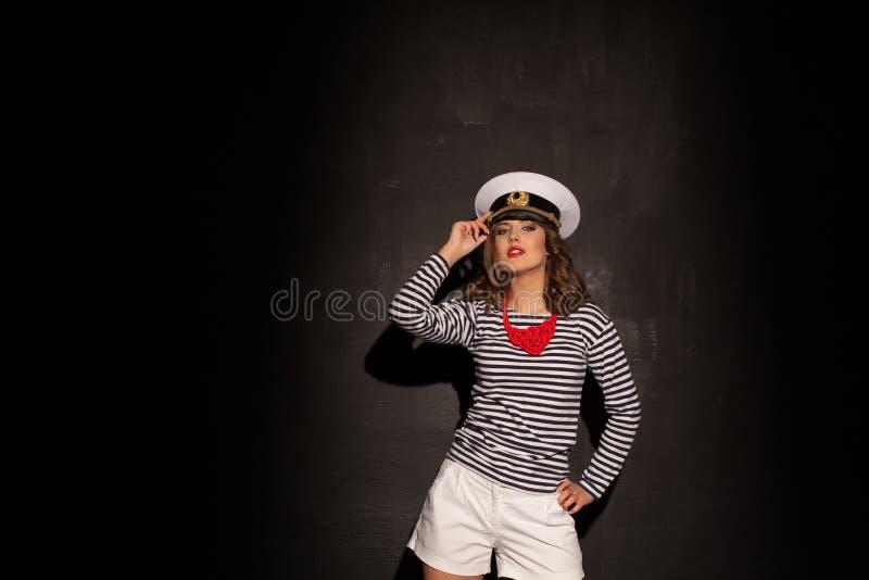 盖帽样式时尚画报的一个女孩 免版税库存图片