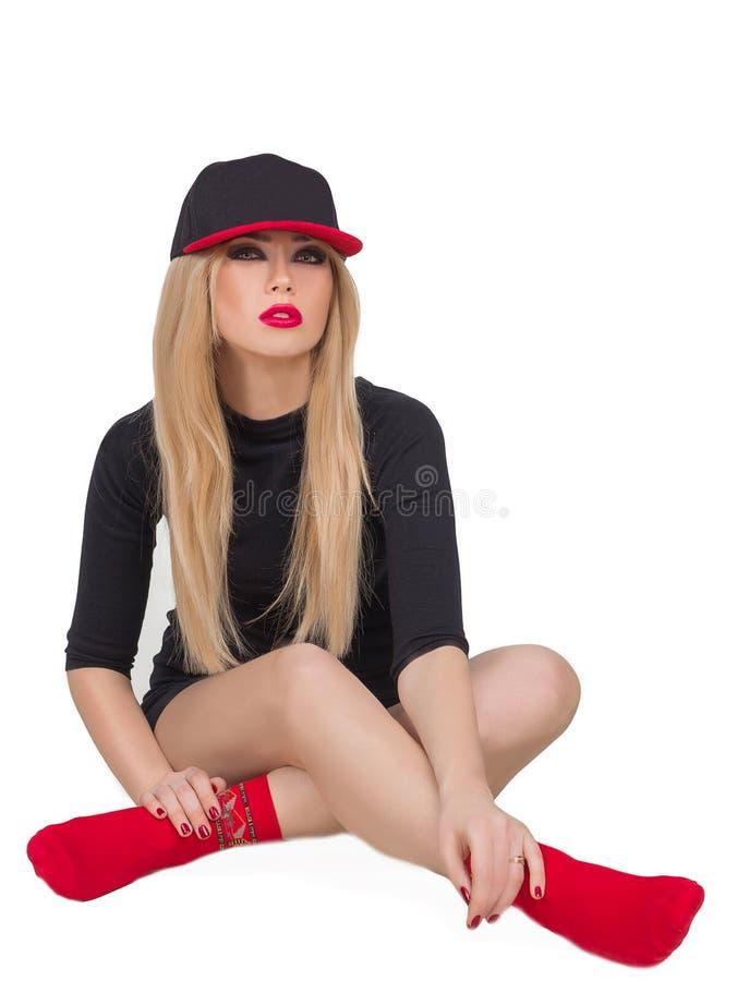 盖帽的一个美丽的女孩 库存照片
