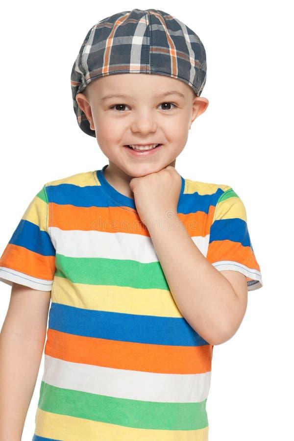 盖帽的快乐的小男孩今后看 库存照片