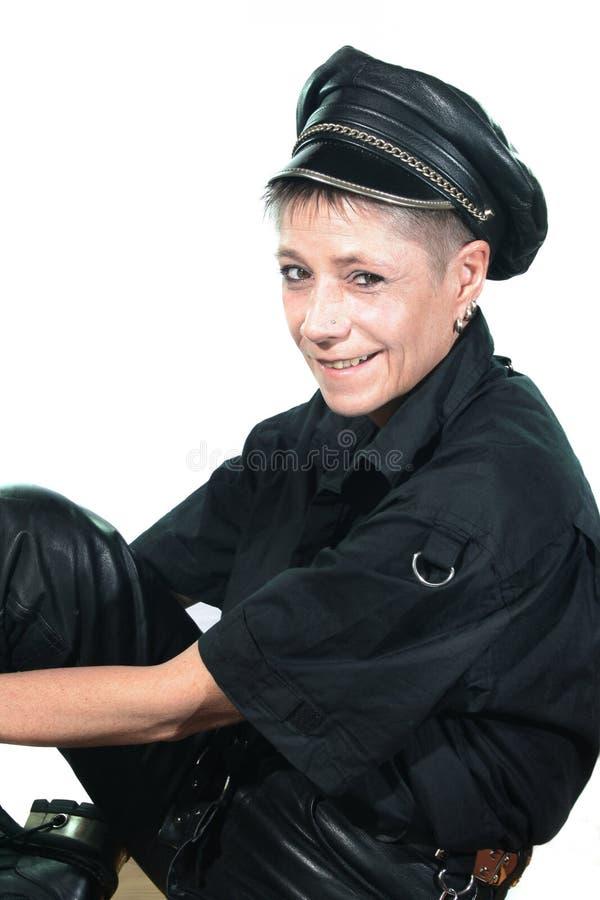 盖帽皮革妇女年轻人 库存图片