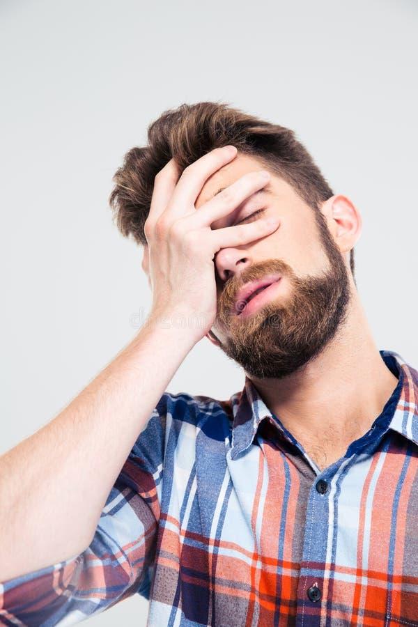 盖他的面孔的哀伤的人画象用手 免版税图库摄影