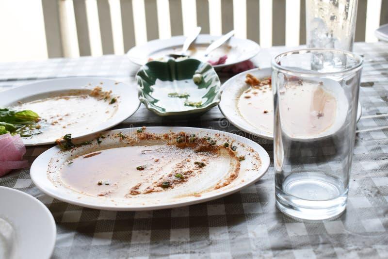 盘和玻璃是肮脏的 免版税库存图片
