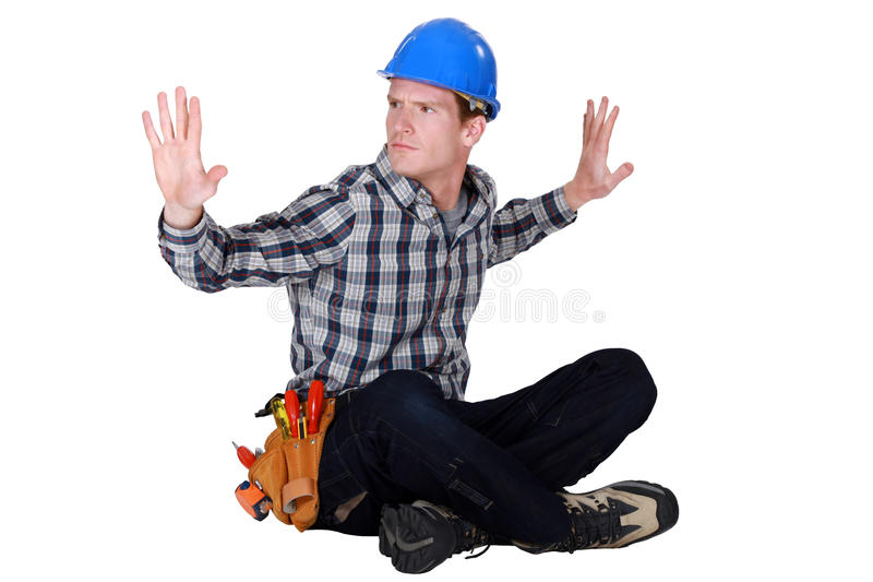 盘着腿坐的工匠 免版税库存照片