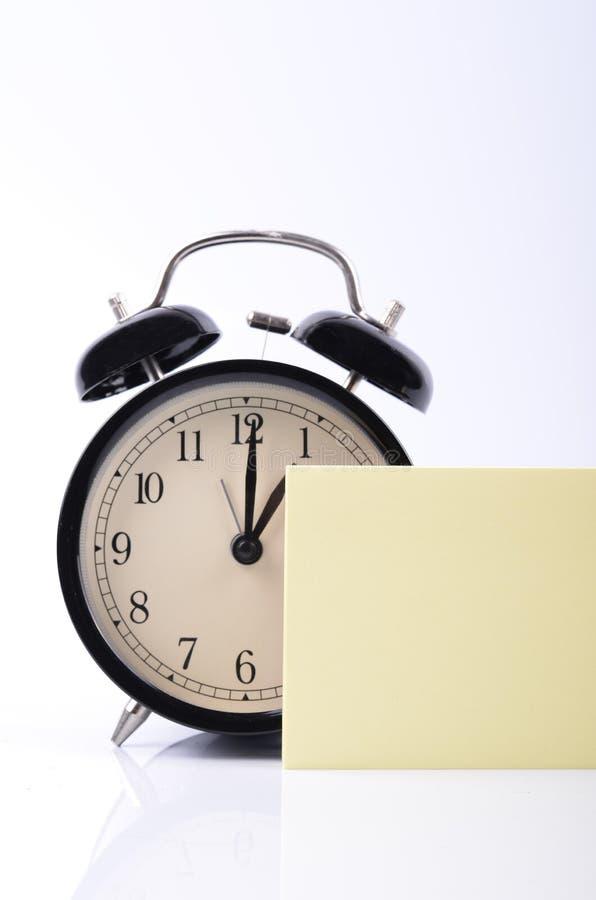 目录备忘录和日程表概念、葡萄酒闹钟和黄色 库存图片