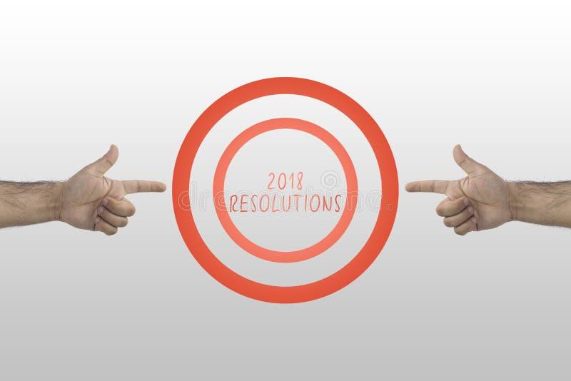 目标和成就概念 指向两只的手瞄准2018年决议 免版税库存图片