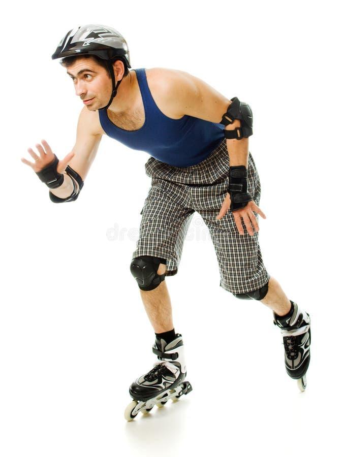 直排轮式溜冰鞋的人 免版税库存图片