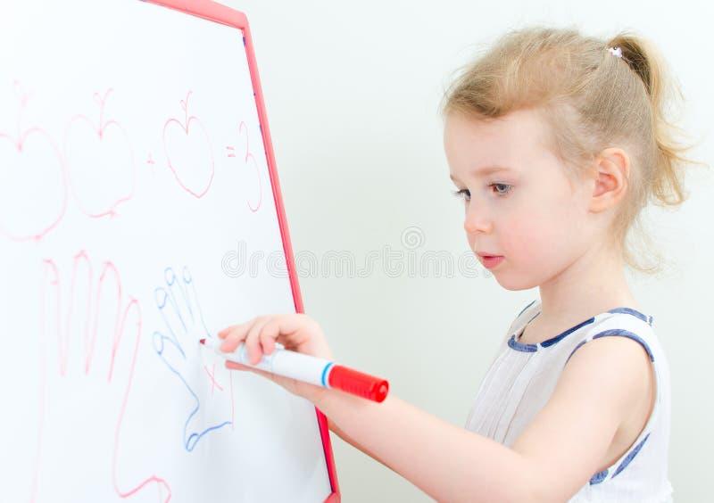 相当与红色标记的小女孩文字 库存图片