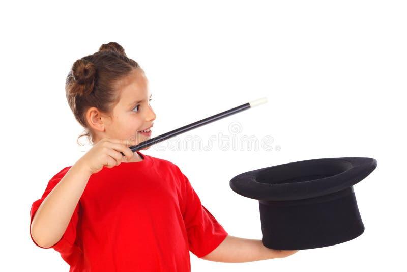 相当做与一顶高顶丝质礼帽和一支不可思议的鞭子的小女孩魔术 库存照片