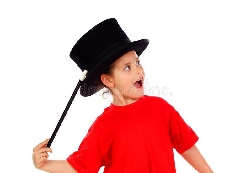 相当做与一顶高顶丝质礼帽和一支不可思议的鞭子的小女孩魔术 库存图片