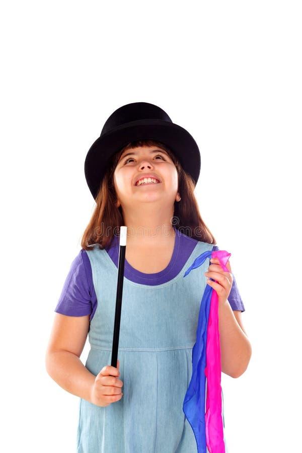 相当做与一顶高顶丝质礼帽和一支不可思议的鞭子的小女孩魔术 免版税图库摄影