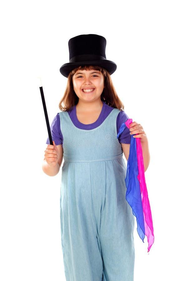 相当做与一顶高顶丝质礼帽和一支不可思议的鞭子的小女孩魔术 图库摄影