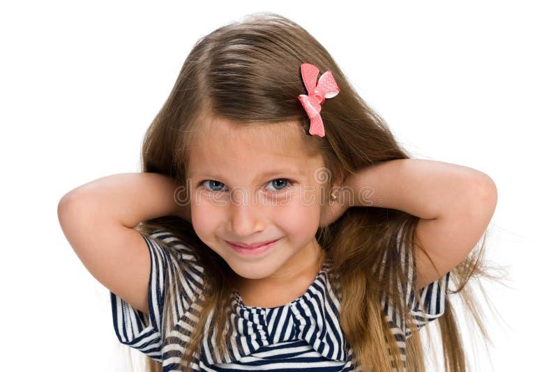 相当愉快的小女孩 免版税库存图片