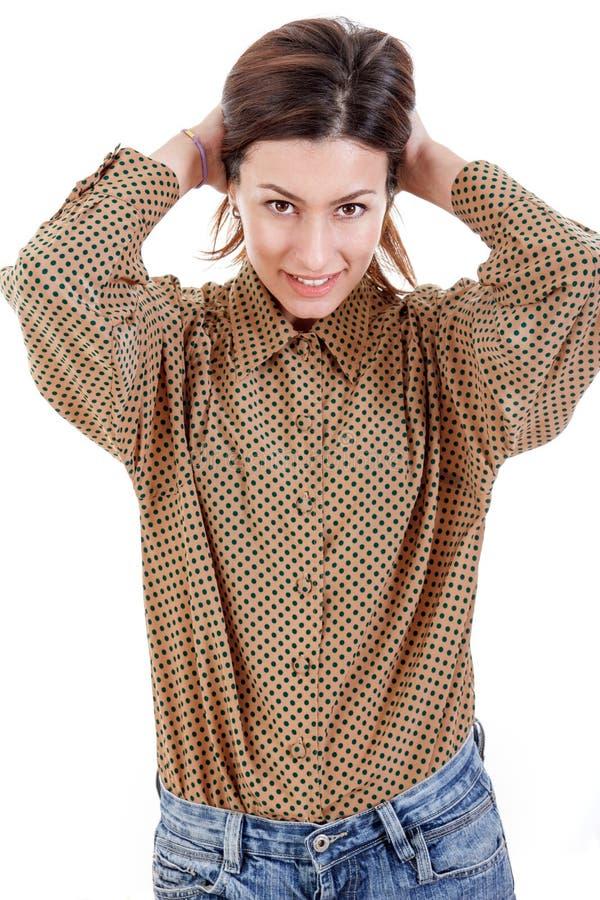 相当拉扯她的头发后面的可爱的偶然女商人 库存照片