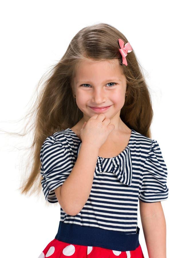 相当有流动的头发的小女孩 免版税库存图片
