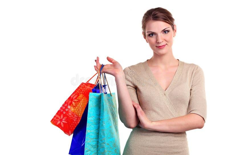 相当有购物袋的少妇纵向  库存照片
