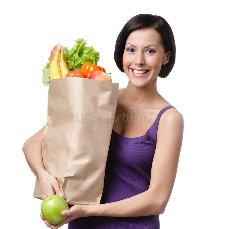 相当有食物包的少妇  免版税库存照片