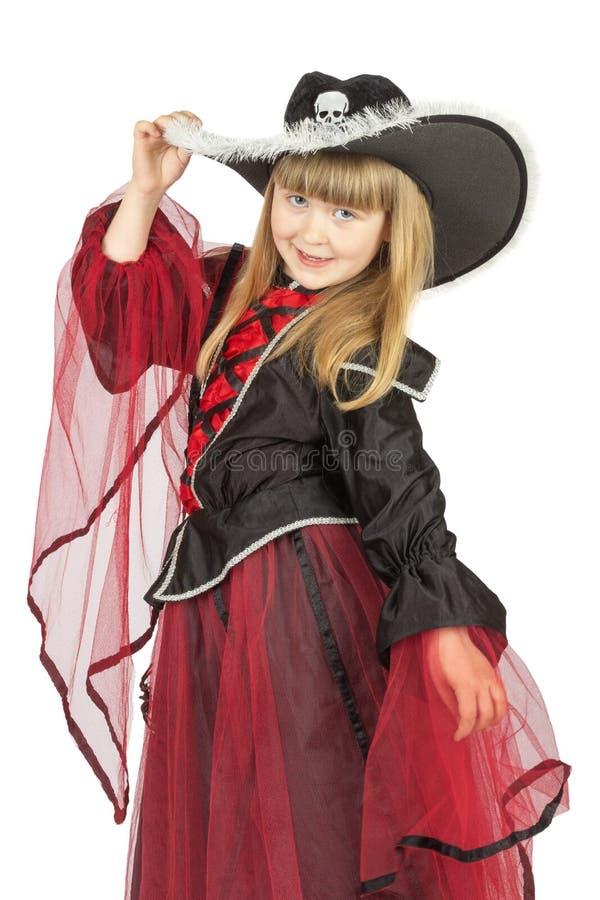 相当海盗服装的小女孩在白色背景 库存图片