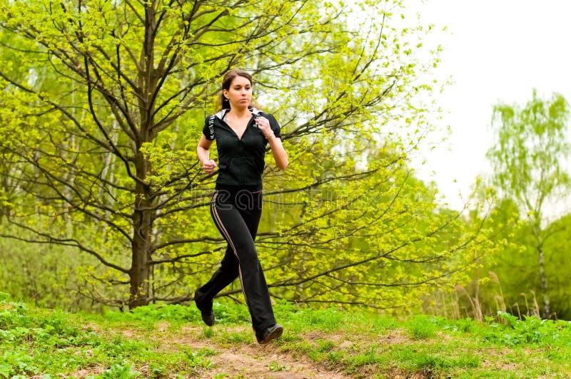 相当跑步的女孩 库存图片