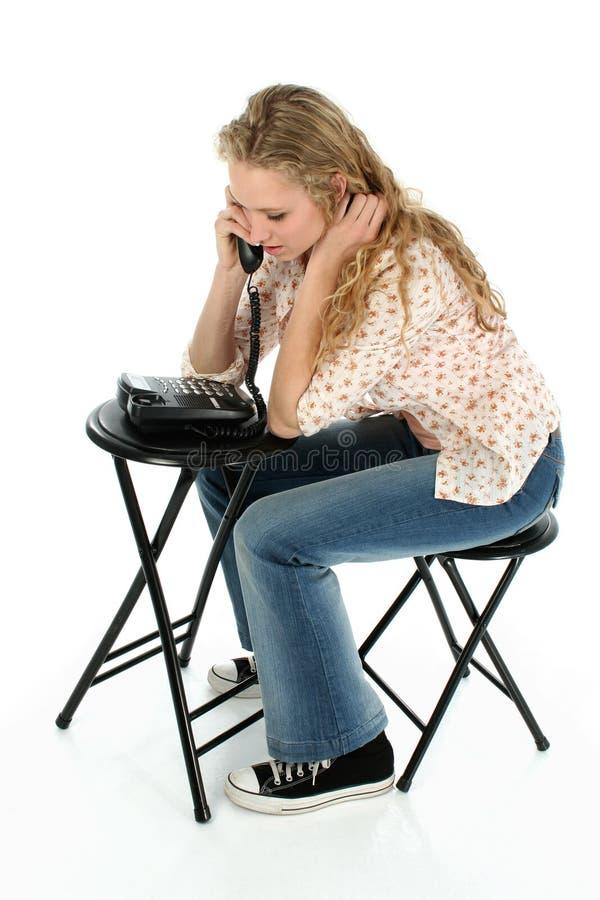 相当青少年女孩的电话 免版税库存图片