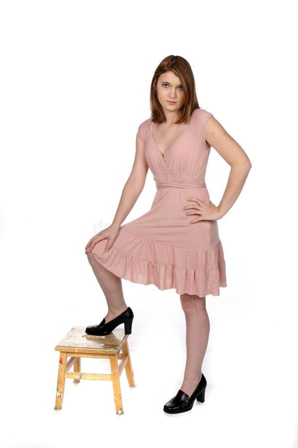 相当青少年礼服的粉红色 免版税图库摄影