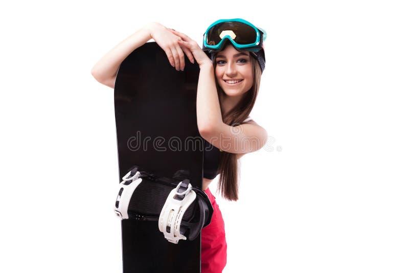 相当黑短的无袖衫举行snowboa的年轻深色的妇女 免版税库存图片