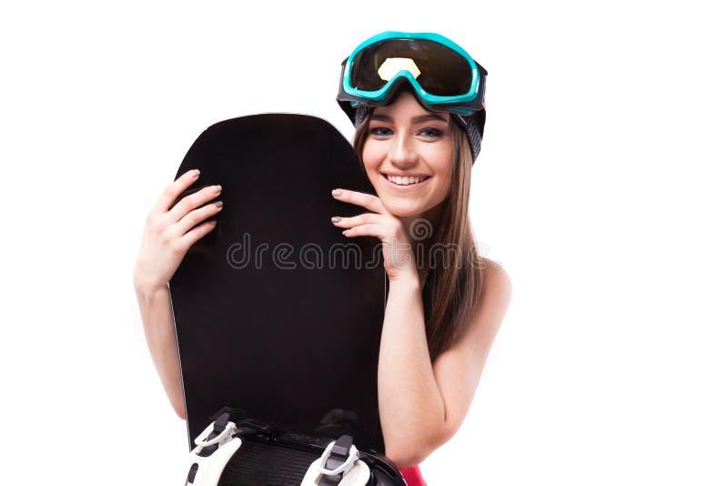 相当黑短的无袖衫举行snowboa的年轻深色的妇女 图库摄影