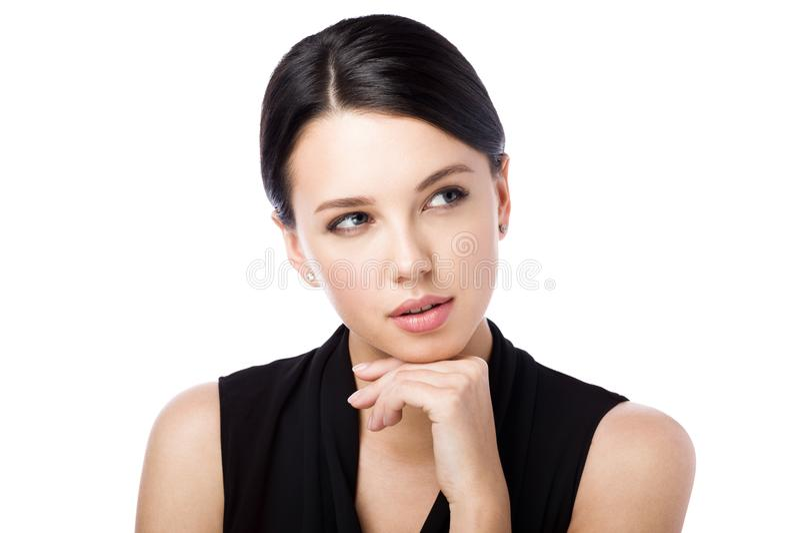 看一名年轻可爱的妇女的画象  考虑某事或选择 免版税库存图片