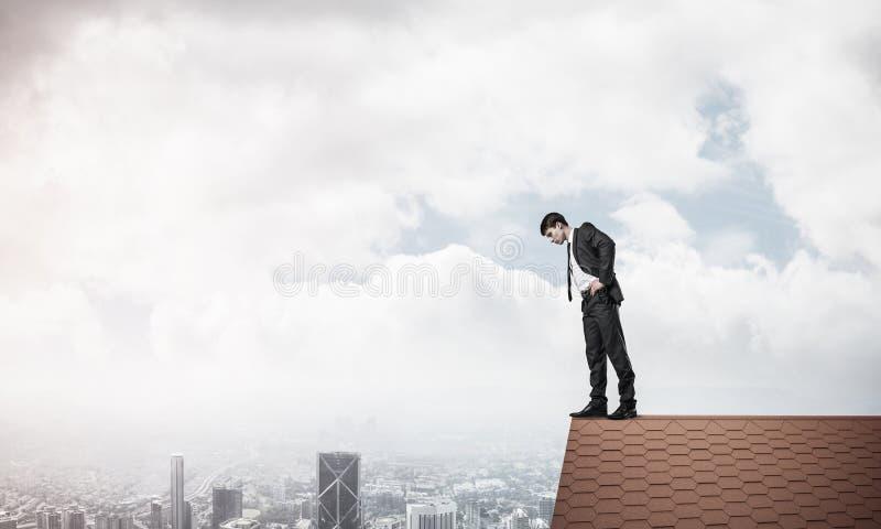 看下来从屋顶的商人和害怕做步 Mixe 免版税库存照片