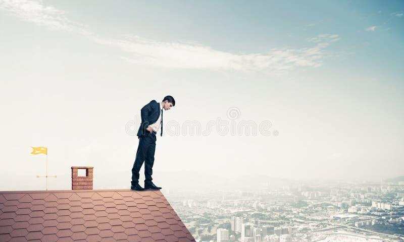 看下来从屋顶的商人和害怕做步 Mixe 免版税库存图片