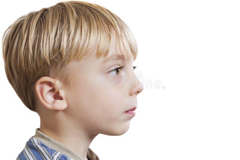 看在白色背景的年轻男孩特写镜头拷贝空间 库存照片