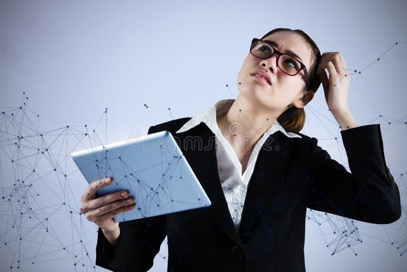 看平板电脑的想法的女实业家的综合图象 库存照片