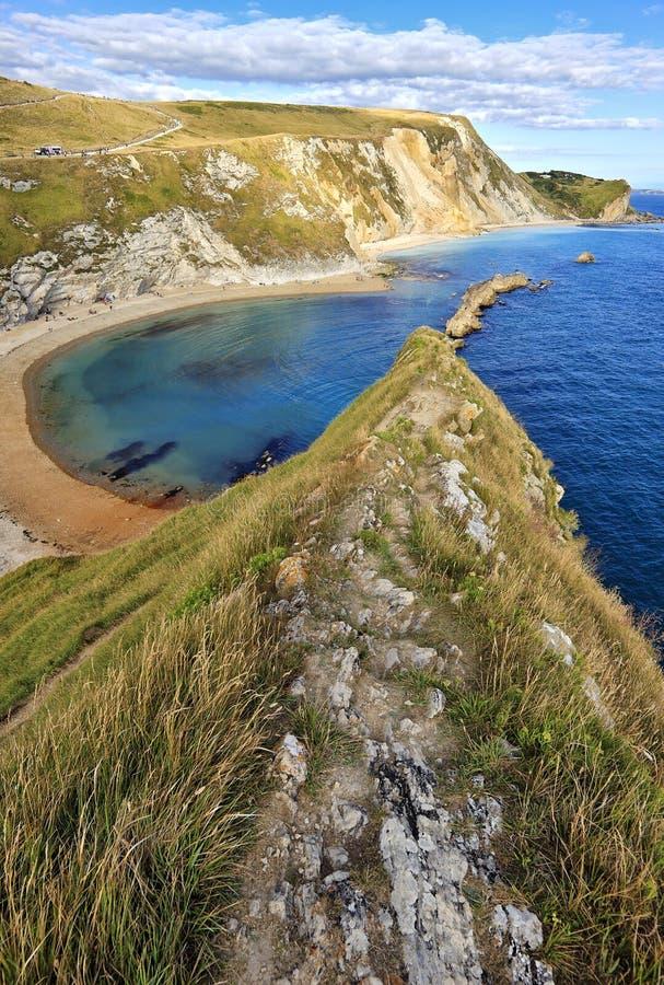 看往西湾的多西特海岸线,着名为它的著名多西特和东德文区侏罗纪海岸和i的化石和部分 免版税图库摄影