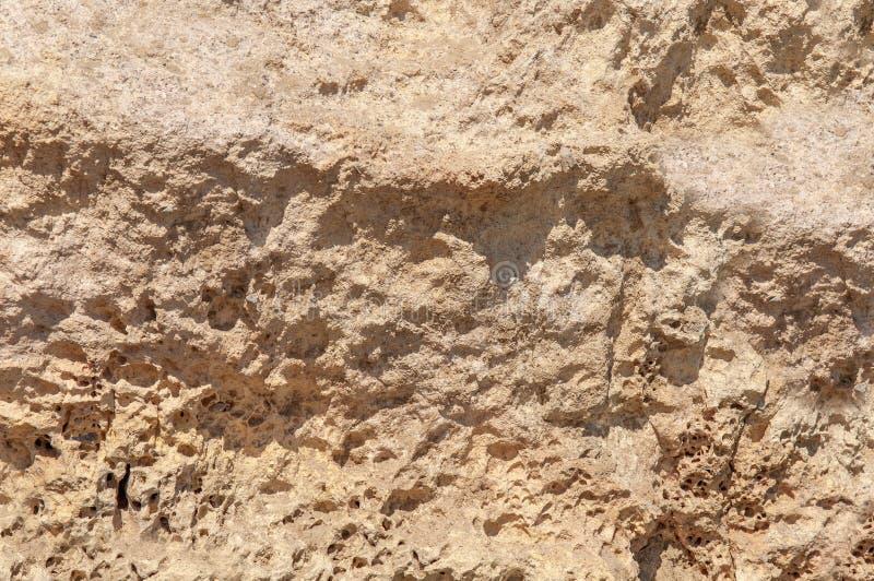 看得这里,自然墙纸岩石表面沿海石纹理 库存图片