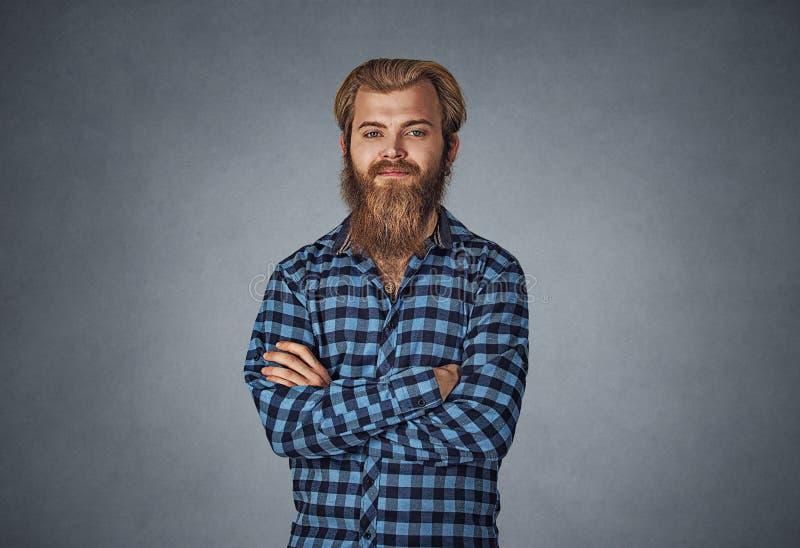 看您的年轻有胡子的人照相机手折叠了 库存照片
